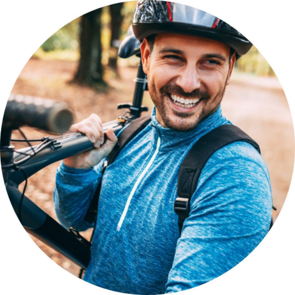 happy health man biking outdoors